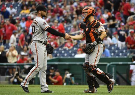 Jun 10, 2018; Washington, DC, USA; San Francisco Giants relief pitcher Hunter Strickland (60) is congratulated by catcher Buster Posey (28) after earning a save against the Washington Nationals at Nationals Park. Mandatory Credit: Brad Mills-USA TODAY Sports