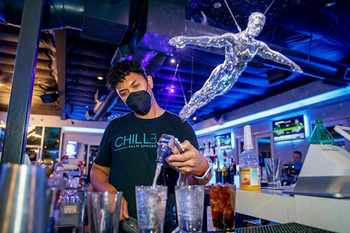 Bartender Masio Winston prepares a drink at Chill Bar in Palm Springs, Calif., on Friday, April 30, 2021.