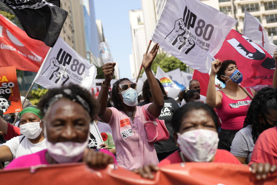 People protest against Brazilian President Jair Bolsonaro's handling of the COVID-19 pandemic, the economy and corruption, on Independence Day in Rio de Janeiro, Brazil, Tuesday, Sept. 7, 2021. (AP Photo/Silvia Izquierdo)