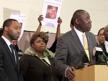 Samaria Rice, the mother of Tamir Rice, the 12-year old boy who was fatally shot by police last month while carrying what turned out to be a replica toy gun, looks on as Benjamin Crump (R) speaks to the media during a news conference at the Olivet Baptist Church in Cleveland, Ohio December 8, 2014. REUTERS/Aaron Josefczyk