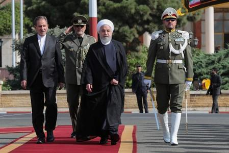 Iranian President Hassan Rouhani walks during a farewell ceremony before leaving for New York, in Tehran