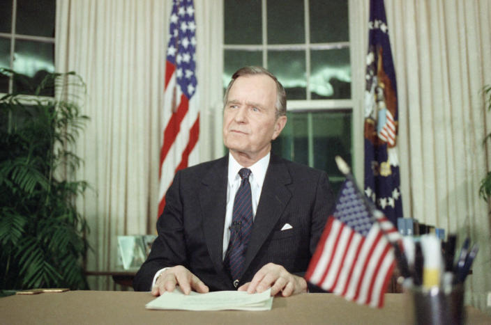 "<p>President George H.W. Bush in the Oval Office of the White House, on Jan. 16, 1991, in Washington, after announcing the U.S. attack on Iraq. The president said, ""The world could wait no longer"" for the U.S. action. (Photo: Doug Mills/AP) </p>"