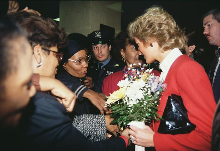 """<p>The following day, the royal visited the AIDS unit of Harlem Hospital, and was so moved that she hugged a 7-year-old child who had AIDS.</p> <p>According to a report by the <a href=""""https://apnews.com/article/86aba3240f517c4c63b49674c0555f7c"""" rel=""""nofollow noopener"""" target=""""_blank"""" data-ylk=""""slk:Associated Press"""" class=""""link rapid-noclick-resp"""">Associated Press</a> at the time, she asked the child, """"Are you heavy?"""" before picking him up ″unrehearsed and of her own volition.""""</p> <p>In doing so, Diana helped to break the stigma at the time that AIDS could be transmitted through touch. </p>"""