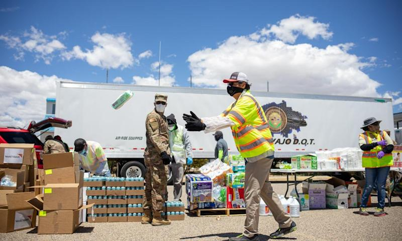 Navajo Nation President Jonathan Nez helps distribute food, water, and other supplies to Navajo families in Huerfano, New Mexico on May 27.