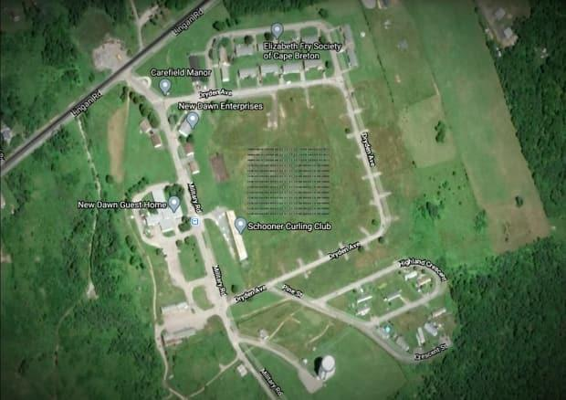 An array of solar panels will be placed in the field at the centre of Pine Tree Park Estates, an affordable living community on the old radar base in Sydney's Whitney Pier neighbourhood. (Submitted by Verschuren Centre for Sustainability in Energy and Environment - image credit)