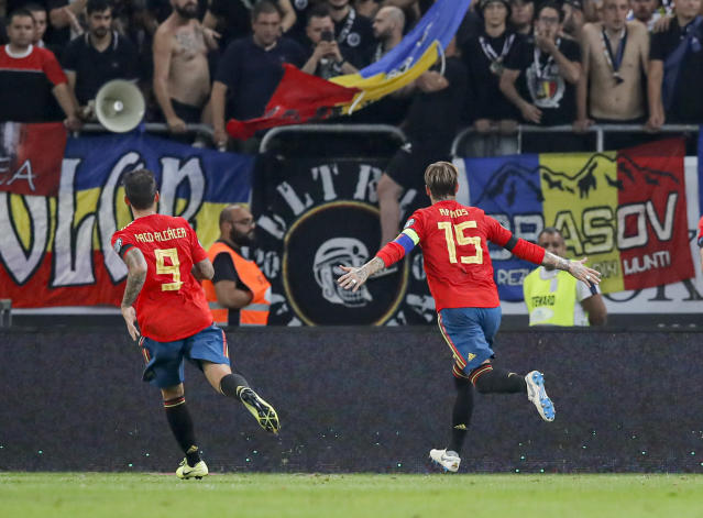 Spain's Sergio Ramos, right celebrates after scoring his side's first goal during the Euro 2020 group F qualifying soccer match between Romania and Spain, at the National Arena stadium in Bucharest, Romania, Thursday, Sept. 5, 2019. (AP Photo/Vadim Ghirda)