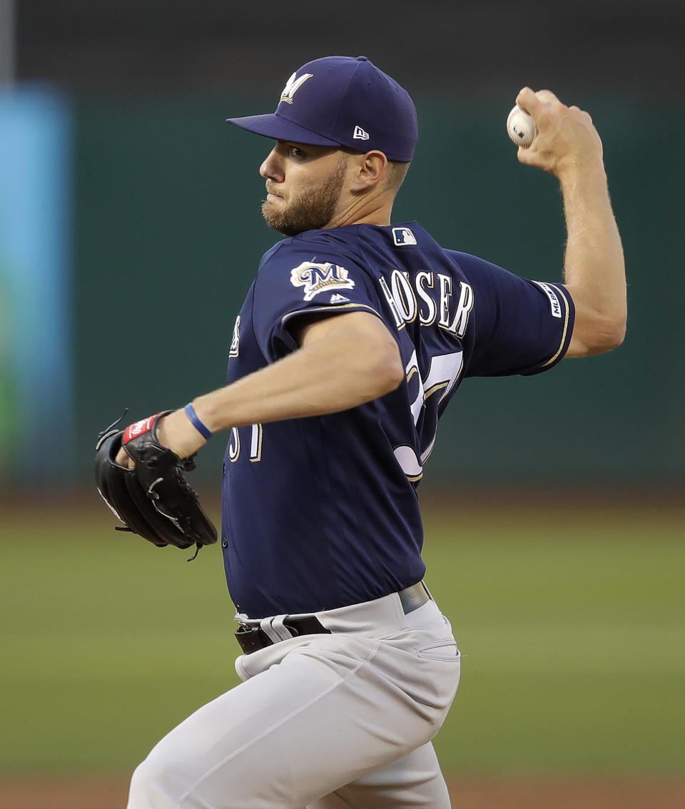 Milwaukee Brewers pitcher Adrian Houser works against the Oakland Athletics during the first inning of a baseball game Tuesday, July 30, 2019, in Oakland, Calif. (AP Photo/Ben Margot)