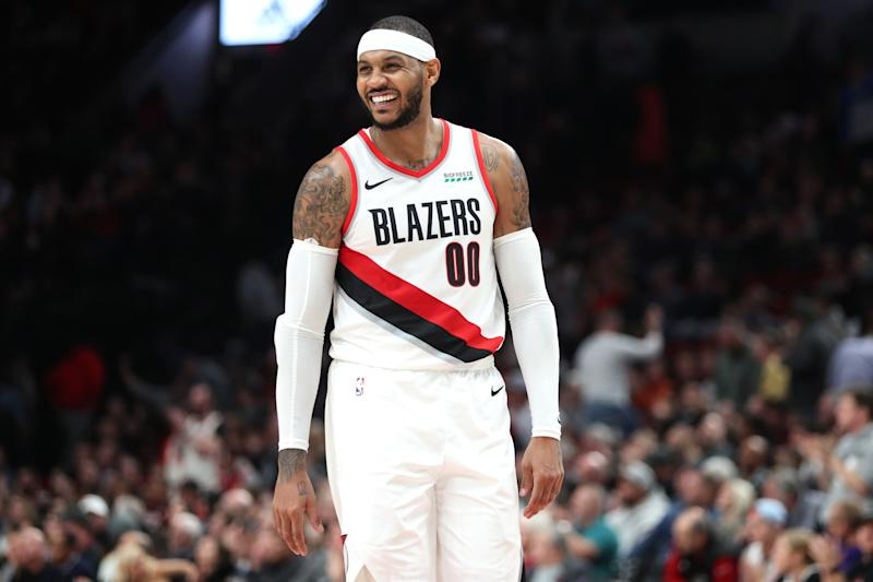 After spending his first seven seasons in the league with the Nuggets, Carmelo Anthony thinks his jersey should hang in the Pepsi Center rafters. (Abbie Parr/Getty Images)