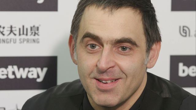 Defending champion Ronnie O'Sullivan said a recurring foot injury was causing him problems at the table.
