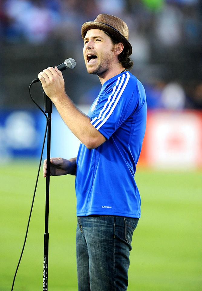 """Ex-""""Idol"""" contestant Michael Johns sings the national anthem, free from concerns about how the viewers will vote or what Simon is gonna say afterward. IOS/London Ent/<a href=""""http://www.splashnewsonline.com"""" target=""""new"""">Splash News</a> - July 21, 2009"""