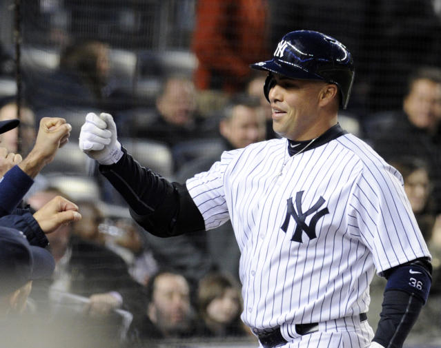 New York Yankees' Carlos Beltran celebrates as he returns to the dugout after hitting a home run during the second inning of a baseball game against the Baltimore Orioles on Wednesday, April 9, 2014, at Yankee Stadium in New York. (AP Photo/Bill Kostroun)