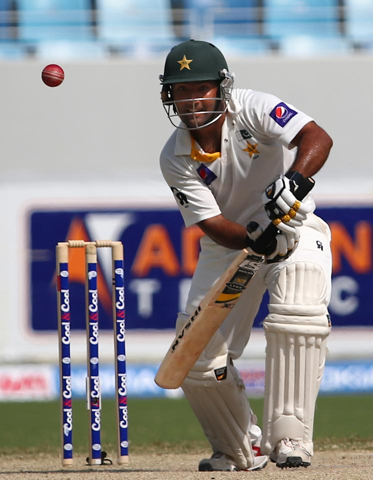 Batsman Asad Shafiq of Paskistan plays a shot during the fourth day of the second Test cricket match between Pakistan and South Africa in Dubai on October 26, 2013. AFP PHOTO/MARWAN NAAMANI        (Photo credit should read MARWAN NAAMANI/AFP/Getty Images)
