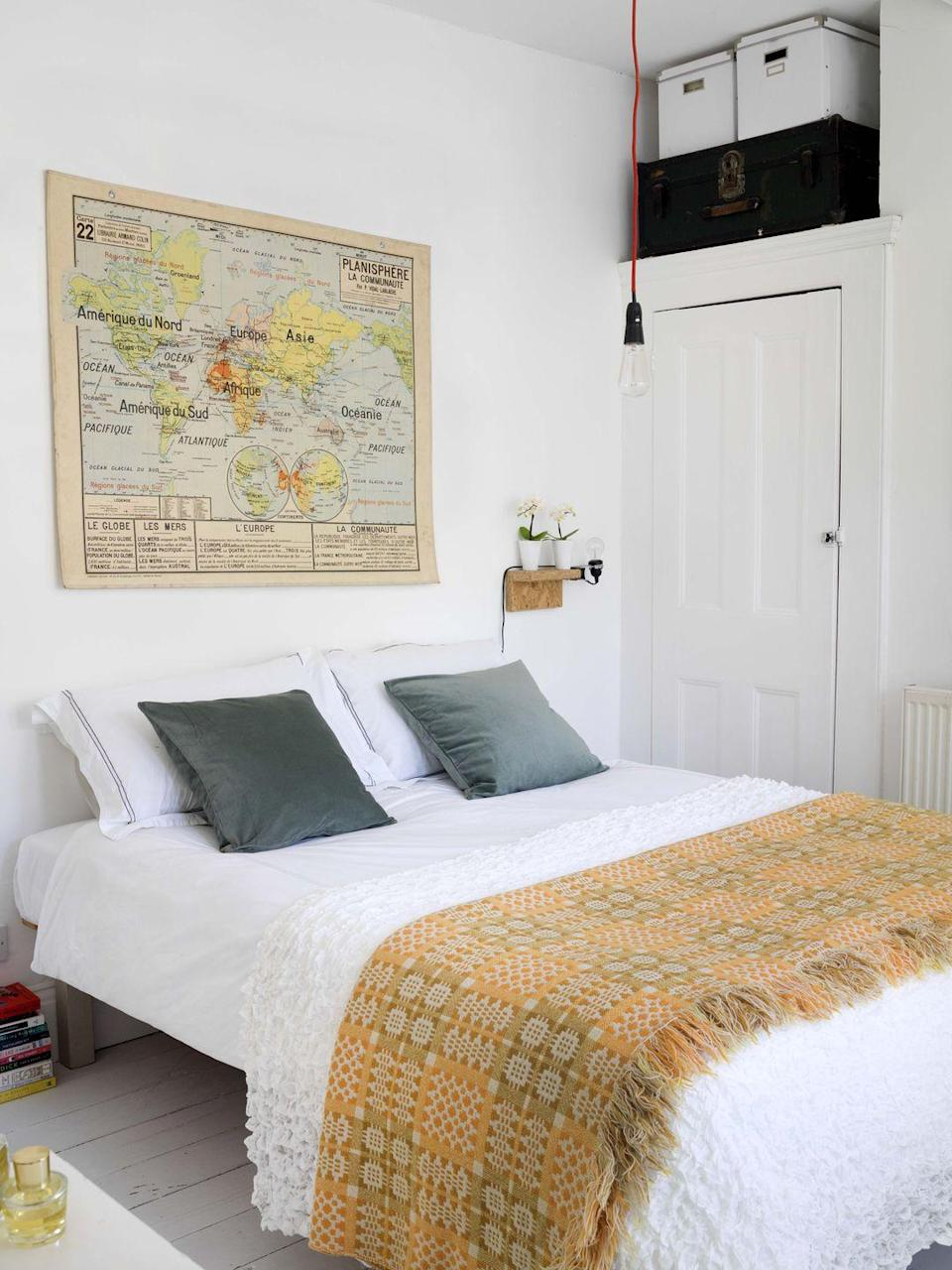"<p>A vintage map makes a great (and inexpensive!) focal point for this simple bedroom. Shop local thrift stores and markets to find one-of-a-kind pieces. </p><p><a href=""https://www.goodhousekeeping.com/home/decorating-ideas/g33339519/boho-living-room-ideas/"" rel=""nofollow noopener"" target=""_blank"" data-ylk=""slk:RELATED: 12 Inspiring Boho Living Room Ideas"" class=""link rapid-noclick-resp""><strong>RELATED:</strong> 12 Inspiring Boho Living Room Ideas</a></p>"