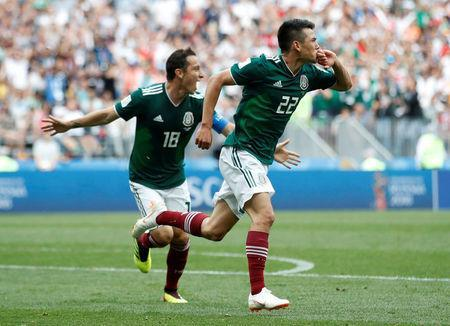 Soccer Football - World Cup - Group F - Germany vs Mexico - Luzhniki Stadium, Moscow, Russia - June 17, 2018 Mexico's Hirving Lozano celebrates scoring their first goal with Andres Guardado REUTERS/Carl Recine