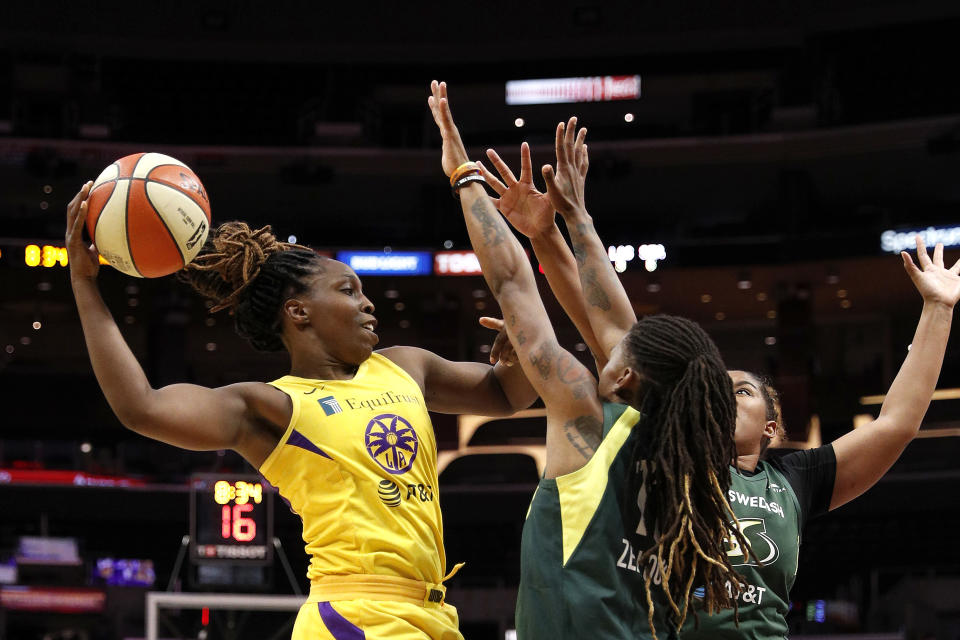 LOS ANGELES, CALIFORNIA - SEPTEMBER 05: Guard Chelsea Gray #12 of the Los Angeles Sparks looks to pass the ball defended by guard Shavonte Zellous #11 of the Seattle Storm at Staples Center on September 05, 2019 in Los Angeles, California. NOTE TO USER: User expressly acknowledges and agrees that, by downloading and or using this photograph, User is consenting to the terms and conditions of the Getty Images License Agreement. (Photo by Meg Oliphant/Getty Images)