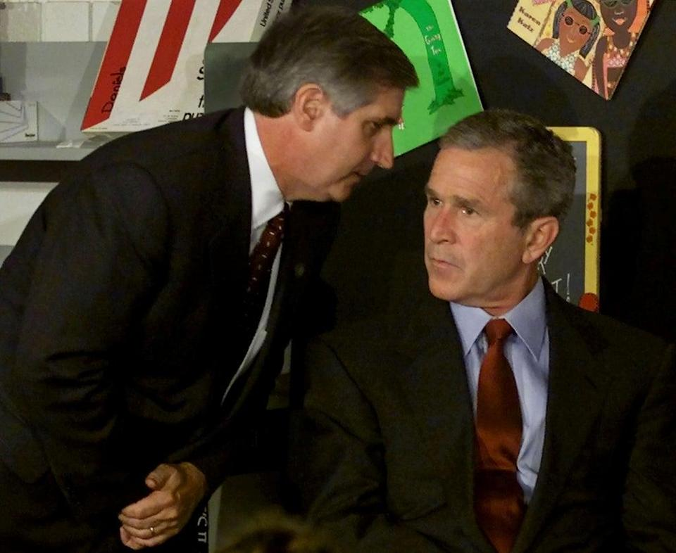 US President George W Bush listens as White House Chief of Staff Andrew Card informs him of a second plane hitting the World Trade Center. Bush was conducting a reading seminar at the Emma E Booker Elementary School, in Sarasota, Florida (Reuters)