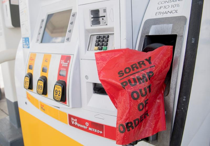 Motorists leaving Miami have found many gas stations cordoned off with yellow tape, signaling they were closed due to lack of fuel (AFP Photo/SAUL LOEB)
