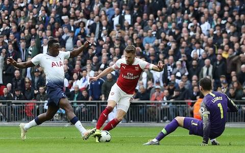 """<span><a class=""""link rapid-noclick-resp"""" href=""""/soccer/players/374479/"""" data-ylk=""""slk:Aaron Ramsey"""">Aaron Ramsey</a> was given space to round Hugo Lloris and open the scoring for Arsenal</span> <span>Credit: AFP </span>"""