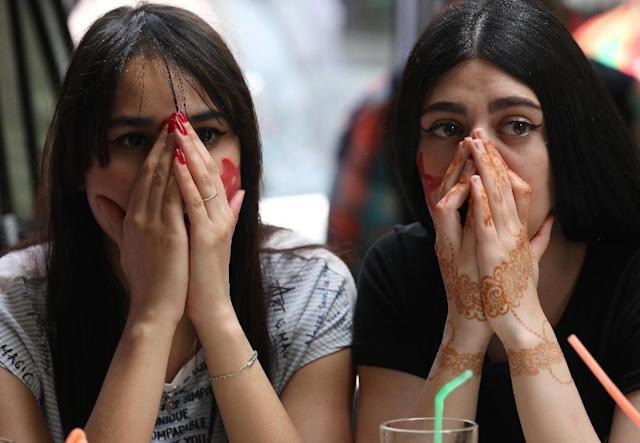 Moroccan women watch their country's World Cup defeat to Portugal (AFP Photo/STR)