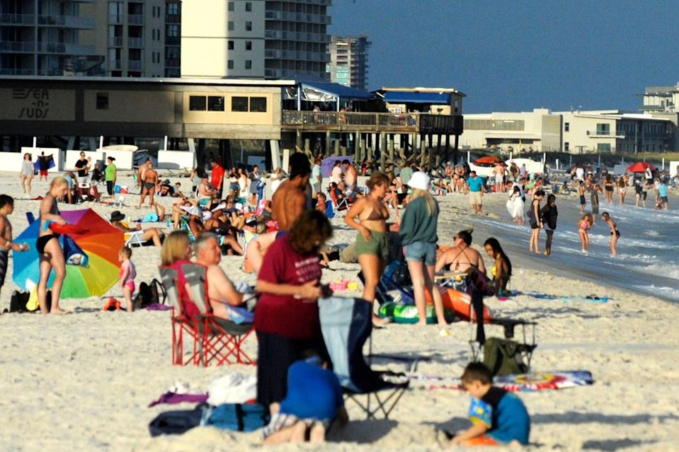 Beachgoers continued to crowd the coast at Gulf Shores, Alabama this August as Covid-19 cases soared in the state (AP)