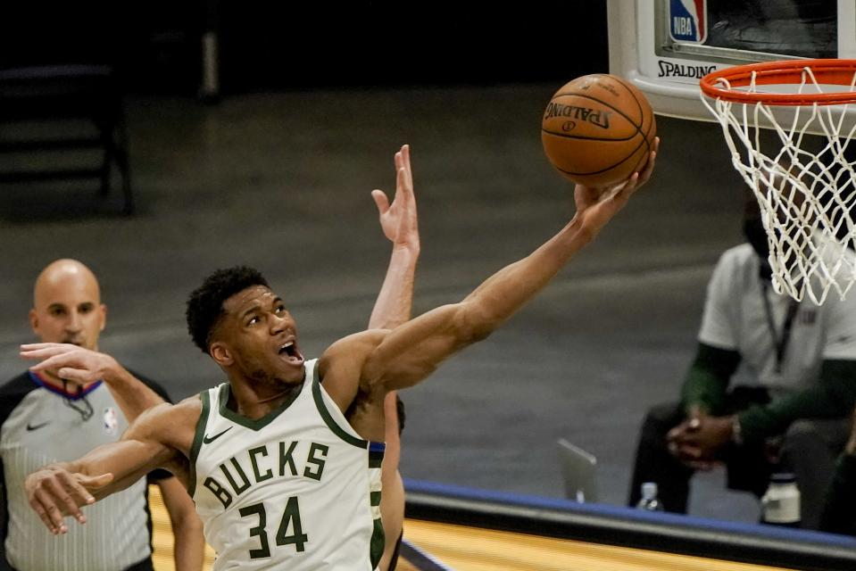 Milwaukee Bucks' Giannis Antetokounmpo shoots during the first half of an NBA basketball game against the Miami Heat Saturday, May 15, 2021, in Milwaukee. (AP Photo/Morry Gash)