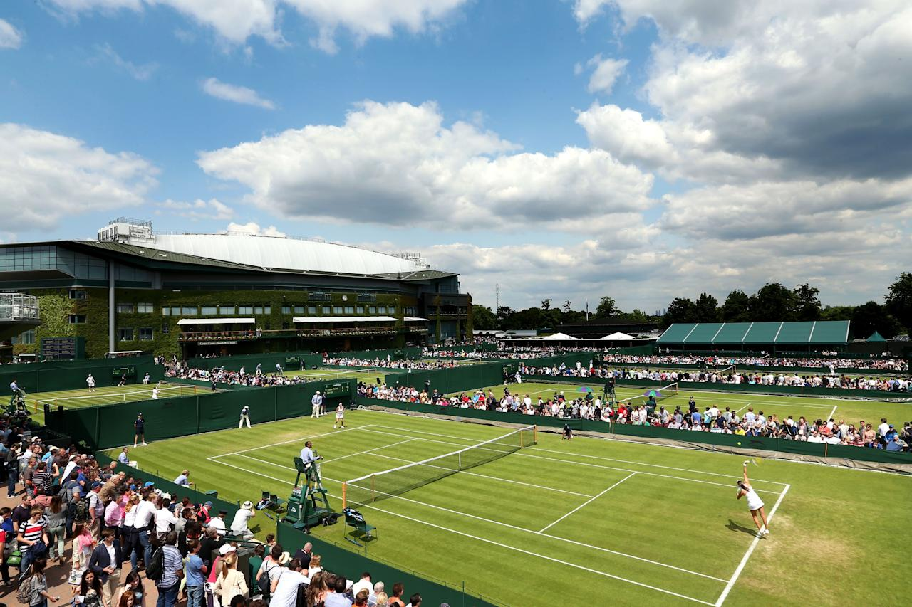 LONDON, ENGLAND - JUNE 25: A general view of action on the outside courts next to Centre Court on day two of the Wimbledon Lawn Tennis Championships at the All England Lawn Tennis and Croquet Club on June 25, 2013 in London, England. (Photo by Clive Brunskill/Getty Images)