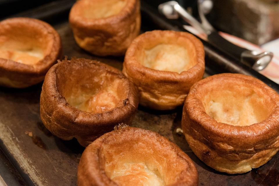"""<p>Yorkshire pudding is an English side dish <a href=""""https://www.thedailymeal.com/cook/pantry-staple-recipes-easy?referrer=yahoo&category=beauty_food&include_utm=1&utm_medium=referral&utm_source=yahoo&utm_campaign=feed"""" rel=""""nofollow noopener"""" target=""""_blank"""" data-ylk=""""slk:made using pantry staples"""" class=""""link rapid-noclick-resp"""">made using pantry staples</a> such as flour, salt, eggs, milk and the leftover pan drippings from beef. New Hampshire is channeling the other side of the pond by looking up how to make this recipe.</p>"""