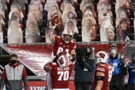 Wisconsin's Jake Ferguson celebrates a touchdown catch during the second half of an NCAA college football game against Illinois Friday, Oct. 23, 2020, in Madison, Wis. Wisconsin won 45-7. (AP Photo/Morry Gash)