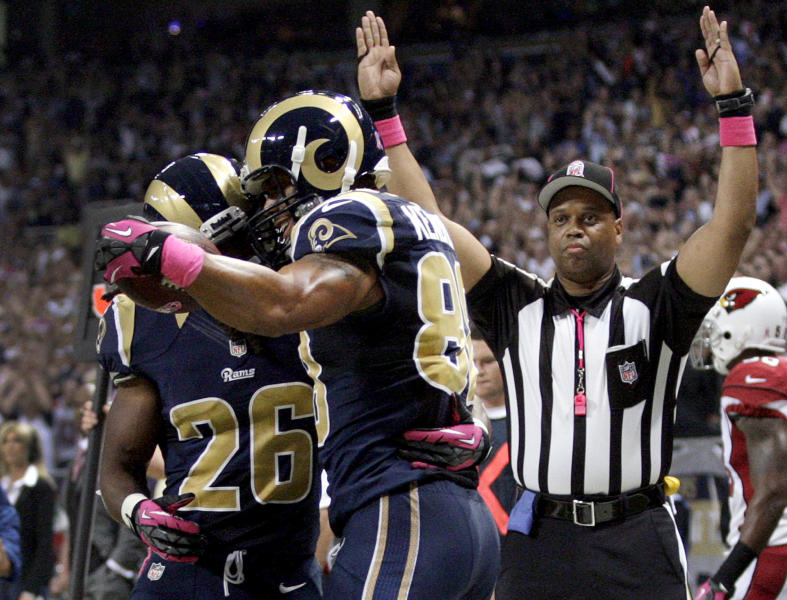 St. Louis Rams tight end Lance Kendricks is congratulated by Daryl Richardson, left, after catching a 7-yard pass for a touchdown during the first quarter of an NFL football game against the Arizona Cardinals, Thursday, Oct. 4, 2012, in St. Louis. (AP Photo/Tom Gannam)