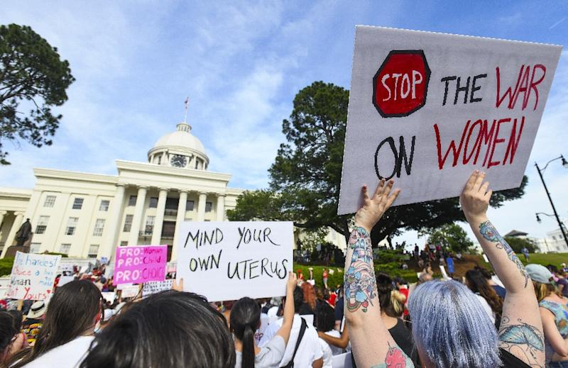 Protestors participate in a rally against one of the nation's most restrictive abortion bans in Alabama, where the traditional separation between church and state has been increasingly blurred
