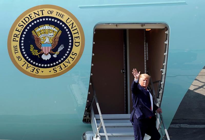 U.S. President Donald Trump waves as he disembarks Air Force One during a refueling stop at Joint Base Elmendorf, Alaska, U.S. on his way to the G-20 Summit in Osaka, Japan, June 26, 2019. REUTERS/Kevin Lamarque TPX IMAGES OF THE DAY