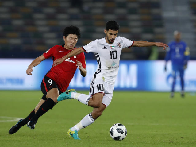 Japan's Urawa Reds Yuki Muto, left, challenges for the ball with Al Jazira's Mark Boussoufa during the Club World Cup soccer match between Al Jazira Club and Urawa Reds at Zayed sport city in Abu Dhabi, United Arab Emirates, Saturday, Dec. 9, 2017. (AP Photo/Hassan Ammar)