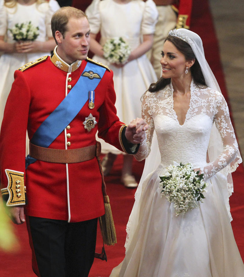 Britain's Prince William, left, and his wife Kate, the Duchess of Cambridge, walk down the aisle hand in hand following their marriage at Westminster Abbey, London, Friday, April 29, 2011.