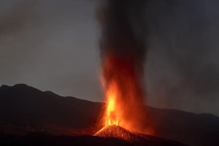 Lava from a volcano eruption flows on the island of La Palma in the Canaries, Spain, Thursday, Sept. 23, 2021. A volcano on a small Spanish island in the Atlantic Ocean erupted on Sunday, forcing the evacuation of thousands of people. Experts say the volcanic eruption and its aftermath on a Spanish island could last for up to 84 days. (AP Photo/Emilio Morenatti)
