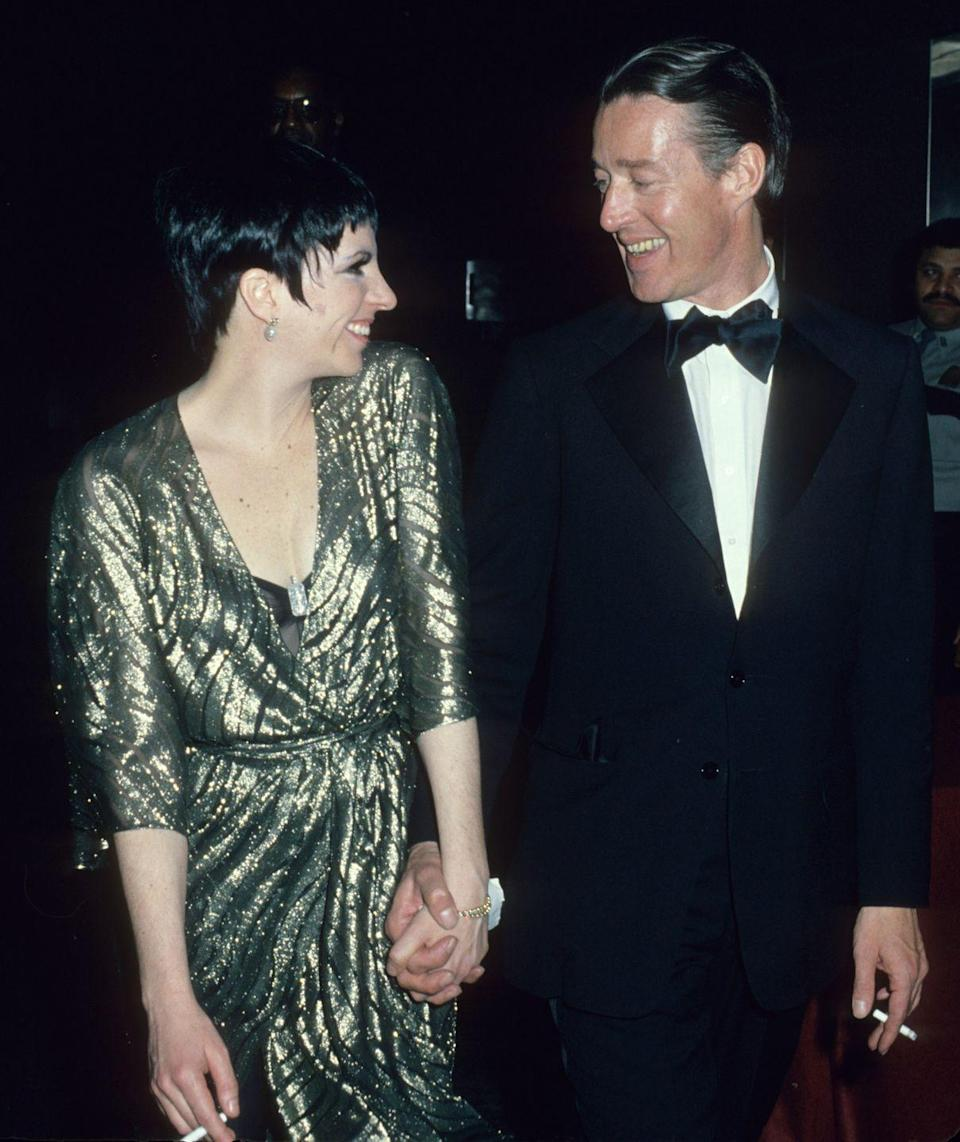 <p>Singer Liza Minnelli was one one of Halston's closest friends, and she was known to wear his designs exclusively. The pair are shown here in Manhattan.</p>