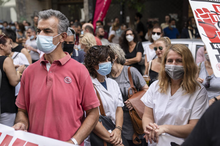 Medical workers take part in a rally outside the Greek Health Ministry to protestregulations mandating coronavirus vaccines for anyone working in their sector, in Athens, on Tuesday, Sept 21, 2021. (AP Photo/Petros Giannakouris)