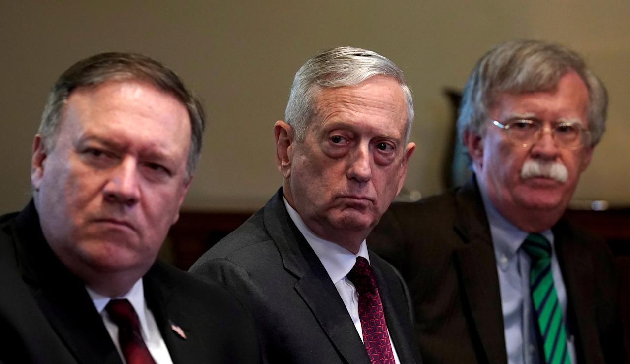 FILE PHOTO: U.S. Secretary of State Mike Pompeo, Secretary of Defense James Mattis (C) and national security adviser John Bolton (R) listen as U.S. President Donald Trump meets with NATO Secretary General Jens Stoltenberg at the White House in Washington, DC, U.S., May 17, 2018.  REUTERS/Kevin Lamarque/File Photo