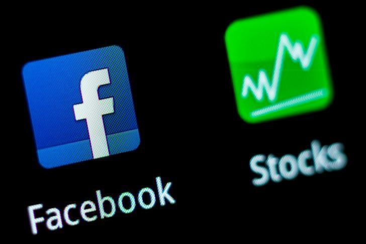 FILE PHOTO: A Facebook application logo is pictured on a mobile phone in this photo illustration taken in Lavigny
