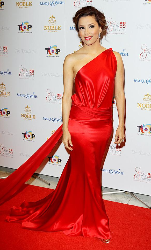 """""""Desperate Housewives"""" darling Eva Longoria stole the spotlight at London's Nobel Gift Gala in a showstopping red silk Ralph & Russo gown, which featured Swarovski crystal accents and a 10-foot train. Danny Martindale/<a href=""""http://www.gettyimages.com/"""" target=""""new"""">GettyImages.com</a> - March 13, 2010"""