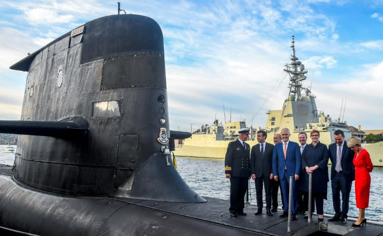 French President Emmanuel Macron (2nd l) and former Australian Prime Minister Malcolm Turnbull (c) had signed a multi-billion dollar submarine contract (AFP/BRENDAN ESPOSITO)