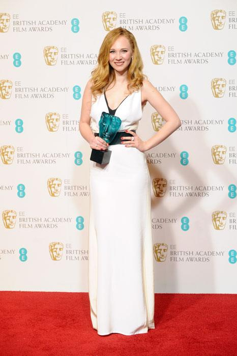 Juno Temple, winner of EE Rising Star, poses in the press room at the EE British Academy Film Awards at The Royal Opera House on February 10, 2013 in London, England. (Photo by Stuart Wilson/Getty Images)