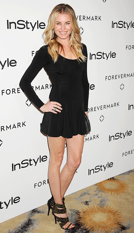 Model/actress Rebecca Romijn flashed her gams in a short and flirty LBD. (1/10/2012)