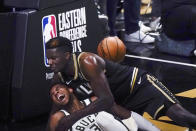 Milwaukee Bucks forward Giannis Antetokounmpo (34) and Atlanta Hawks center Clint Capela fall to the court during the second half of Game 4 of the NBA basketball Eastern Conference finals Tuesday, June 29, 2021, in Atlanta. (AP Photo/Brynn Anderson)