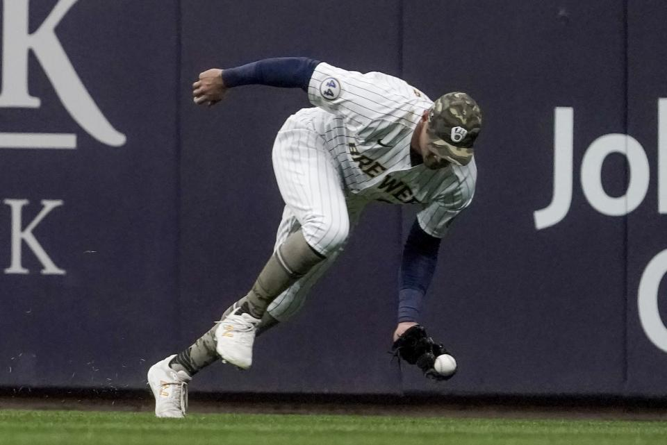 Milwaukee Brewers' Avisail Garcia makes a catch on a ball hit by Atlanta Braves' Freddie Freeman during the third inning of a baseball game Friday, May 14, 2021, in Milwaukee. (AP Photo/Morry Gash)