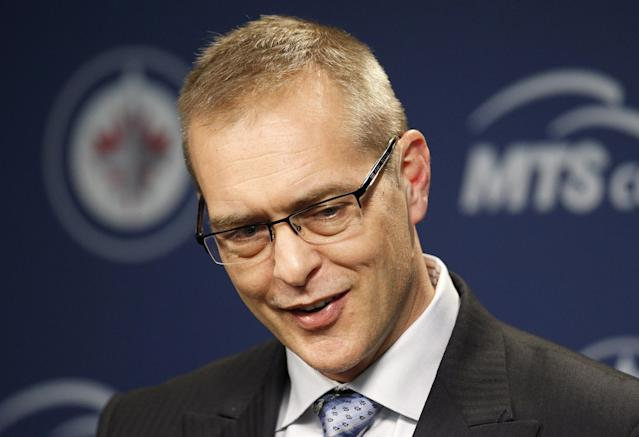 Winnipeg Jets head coach Paul Maurice smiles during a post game news conference following the team's win over the Phoenix Coyotes during NHL hockey action in Winnipeg, Canada, Monday, Jan. 13, 2014. (AP Photo/The Canadian Press, Trevor Hagan)