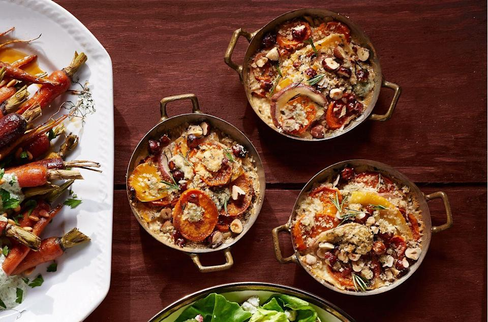 "<p>Everybody gets their own individual serving of this vegetarian dish. <br></p><p><strong><a href=""https://www.countryliving.com/food-drinks/recipes/a36646/root-vegetable-gratin/"" rel=""nofollow noopener"" target=""_blank"" data-ylk=""slk:Get the recipe"" class=""link rapid-noclick-resp"">Get the recipe</a>.</strong></p>"