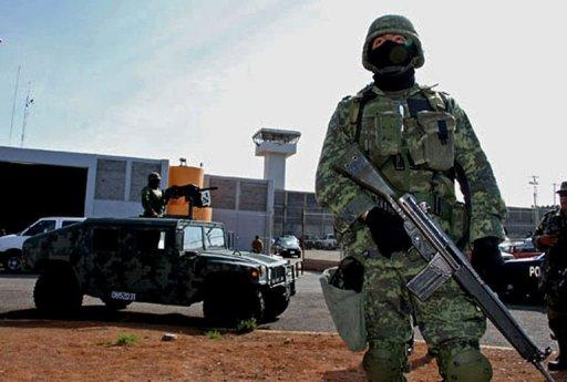 Some 5,000 Mexican soldiers and police are searching for 131 escaped prisoners near the US border