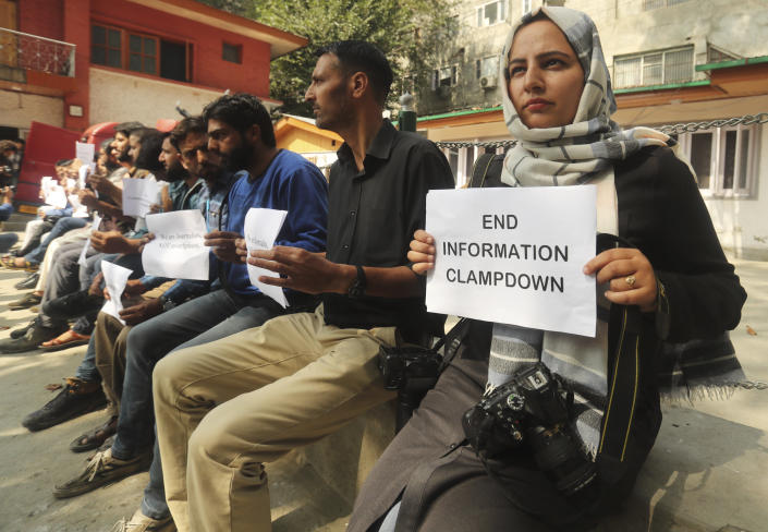 Kashmiri journalists display placards during a protest against the communication blackout in Srinagar, Indian controlled Kashmir, Thursday, Oct. 3, 2019. For the last two months, mobile phones and internet services have been shut down in the valley after New Delhi stripped Indian-controlled Kashmir of its semi-autonomous powers and implemented a strict clampdown, snapping communications networks, landlines and mobile Internet. (AP Photo/Mukhtar Khan)