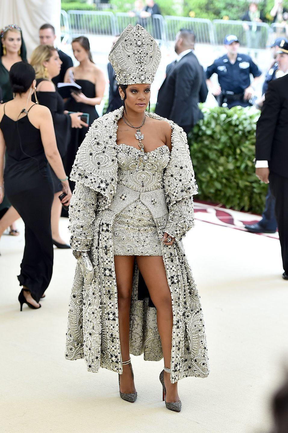 """<p>The theme of the 2018 Met Gala was Heavenly Bodies, and Rihanna certainly delivered in this beaded John Galliano dress and matching pope-inspired headpiece. But not everyone was a fan. Some <a href=""""https://www.standard.co.uk/showbiz/celebrity-news/rihanna-channels-popechic-with-religious-met-gala-gown-but-catholics-are-fuming-with-disgusting-outfit-a3832891.html"""" rel=""""nofollow noopener"""" target=""""_blank"""" data-ylk=""""slk:people on social media"""" class=""""link rapid-noclick-resp"""">people on social media</a> slammed Rihanna, saying the outfit was """"so offensive"""" and made """"a mockery of Christian religion.""""</p>"""