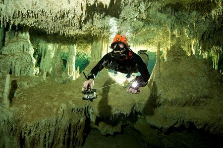 A scuba diver measures the length of Sac Aktun underwater cave system as part of the Gran Acuifero Maya Project near Tulum, in Quintana Roo state, Mexico January 24, 2014. Picture taken January 24, 2014. Herbert Mayrl/Courtesy Gran Acuifero Maya Project (GAM)/Handout via REUTERS